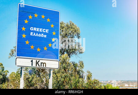 Road sign on the border of Greece as part of an European Union member state. - Stock Image