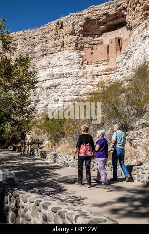 Visitors below Montezuma Castle cliff dwelling, Montezuma Castle National Monument, Arizona USA - Stock Image