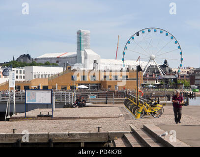 SkyWheel ferris wheel, Allas Sea Pool, restaurant and sun deck and viewpoint in the central harbor next to Kauppatori inHelsinki Finland, - Stock Image