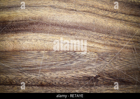 Vintage wooden cutting board with scratches and vignette. Image shot from above in flat lay position. - Stock Image