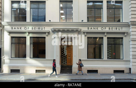 Exterior of and entrance to the Head Office of the Bank of Beirut (UK) Ltd in Cannon Street, in the City of London, England, UK. Two female pedestrian - Stock Image