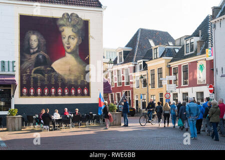 Leeuwarden, Netherlands - tourists looking at mural of Landgravine Marie Louise of Hesse-Kassel during Leeuwarden-Friesland Capital of Culture 2018 - Stock Image
