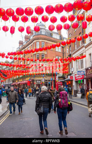 Tourists people men women in London's China town - Stock Image