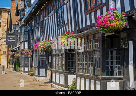 Stratford upon Avon and the Shakespeare hotel  with colourful hanging baskets. - Stock Image