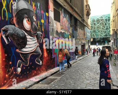 Hosier Lane in Melbourne with Federation Square in background with graffiti art on walls - Stock Image