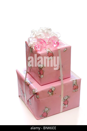 Wrapped gifts for the baby girl - Stock Image