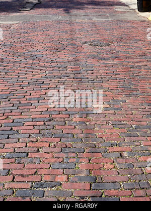 Old warn cobblestone or brick street or road also known as pavers in Montgomery Alabama, USA. - Stock Image
