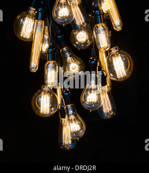 group of hanging incandescent bulbs - Stock Image