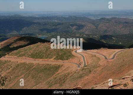Cars on road to Pikes Peak National Park ridge Colorado Rocky Mountain - Stock Image
