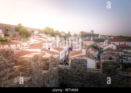 Obidos medieval town at sunset, Portugal - Stock Image