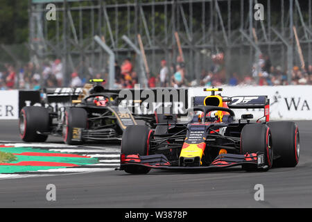 Silverstone Circuit. Northampton, UK. 13th July, 2019. FIA Formula 1 Grand Prix of Britain, Qualification Day; Pierre Gasly driving his Aston Martin Red Bull Racing RB15 ahead of Kevin Magnussen driving his Rich Energy Haas F1 Team VF-19 Credit: Action Plus Sports/Alamy Live News - Stock Image