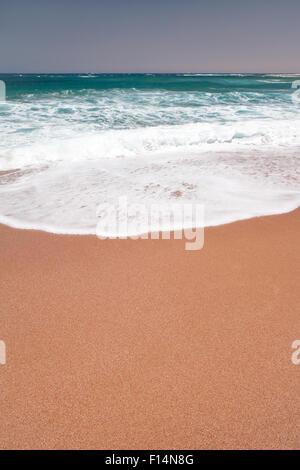 Sea wave and sand on the beach - Stock Image