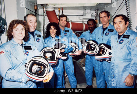 Left to right are Teacher-in-Space payload specialist Sharon Christa McAuliffe; payload specialist Gregory Jarvis; and astronauts Judith A. Resnik, mission specialist; Francis R. (Dick) Scobee, mission commander; Ronald E. McNair, mission specialist; Mike J. Smith, pilot; and Ellison S. Onizuka, mission specialist. - Stock Image