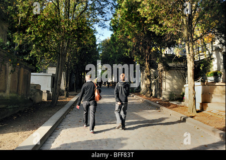 Paris, France - Street Scene, 'Pere Lachaise Cemetery', Mother and Son Walking on Cobbled Stone Road in - Stock Image