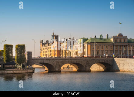 Stockholm, Sweden. Cityscape view of historic buildings on Stromgaten, with Norrbro arched bridge in the centre of Stockholm on a sunny autumn day. - Stock Image
