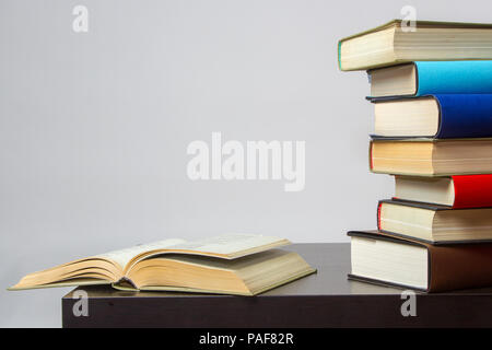 Composition of books and studies on table copy space - Stock Image