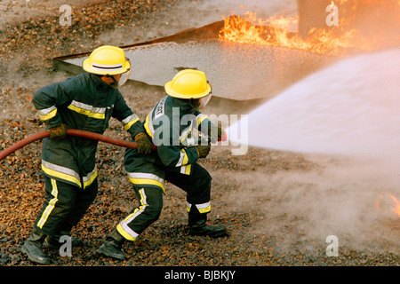 Airport firefighters, UK - Stock Image