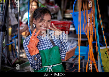 Thailand street food vendor, happy smiling young Thai female vendor at her street market venue - Stock Image