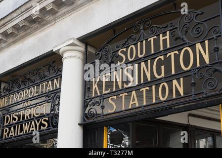 Wrought iron frieze and station name above entrance to South Kensington underground station, London, England, UK - Stock Image