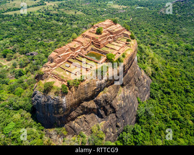 Sigiriya or the Lion Rock, an ancient fortress and a palace with gardens, pools, and terraces atop of granite rock in Dambulla, Sri Lanka. Aerial view. - Stock Image