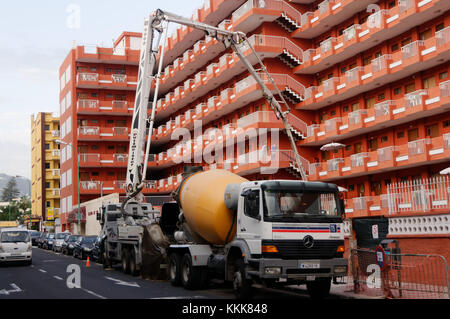 concrete pump pumps cement building construction lifting pumping working at hight sites site - Stock Image