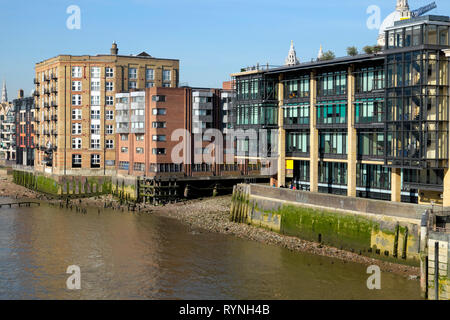 View of buildings along the north side of the River Thames riverwalk near the ancient dock of Queenhithe in City of London England UK  KATHY DEWITT - Stock Image