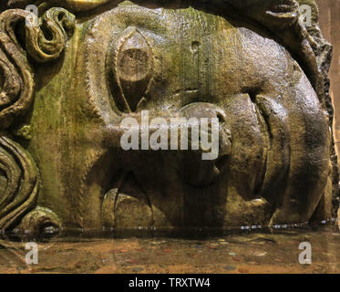 Medusa head in the Basilica Cisterna in Istanbul, Turkey. It is 143m long and 65m wide underground water container, the one of most popular tourist at - Stock Image