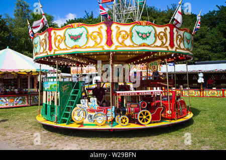 90th Kent County Show, Detling, 6th July 2019. A small child's Carousel. - Stock Image