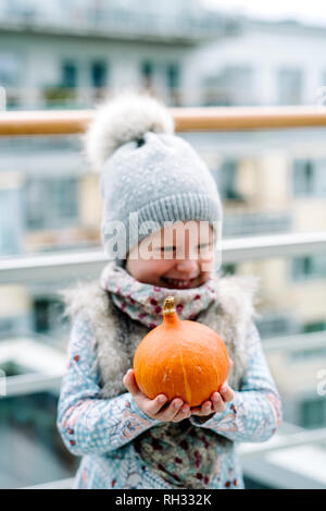 Boy holding pumpkin outdoors - Stock Image
