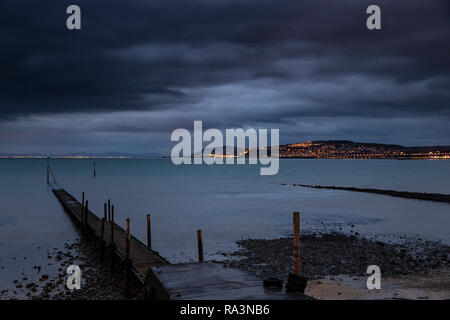Jetty at Rhos-on-Sea at night on the North Wales coast - Stock Image