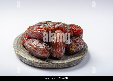 Pile of sweet tasty dried dates fruits close up, isolated - Stock Image