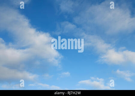 A blue sky with light cloud - Stock Image