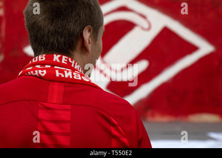 Football club Spartak fan on the background of the club emblem in Moscow, Russia - Stock Image