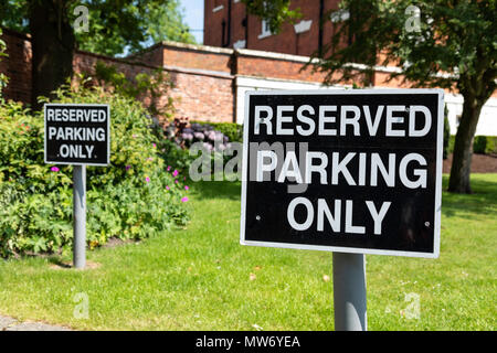 Two black and white  reserved parking only signs located at Warrington Town Hall Bank Park Warrington Cheshire May 2018 - Stock Image