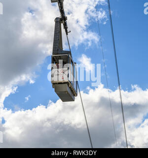 Cable car in a blue sky with cloud over Gibraltar; Gibraltar - Stock Image