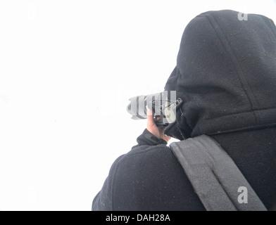 Winter photographer - Stock Image