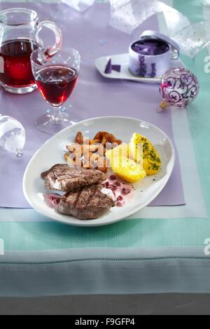Medallions with cranberry and fried chantarelles - Stock Image