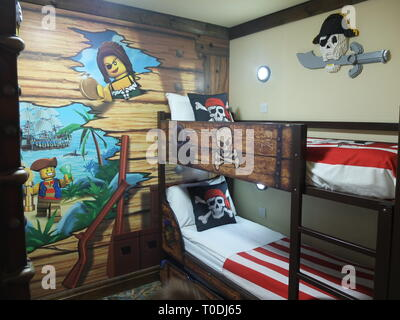 Childs bunk beds and décor in one of Premium Pirate Rooms at the hotel at LEGOLAND Windsor Resort UK - Stock Image