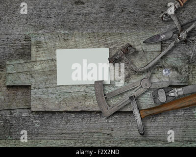 vintage jeweler tools and diamond over wooden bench, blank card for your business - Stock Image
