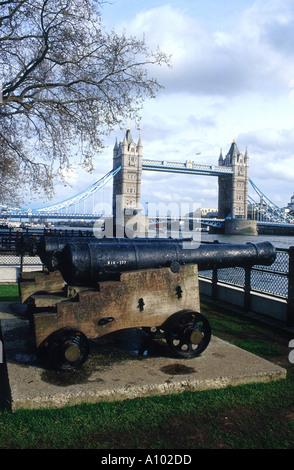 Canon and Tower Bridge London England - Stock Image