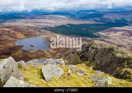 High view above Llyn Y Foel lake from Daear Ddu east ridge on Carnedd Moel Siabod mountain in mountains of Snowdonia - Stock Image