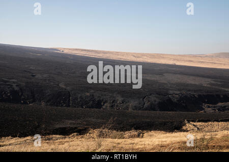 Marsden, UK. 27th Feb, 2019. Scorched moorland was still smouldering this afternoon following the dramatic fire overnight at Marsden Moor, near Saddleworth Moor. Credit: James Copeland/Alamy Live News - Stock Image