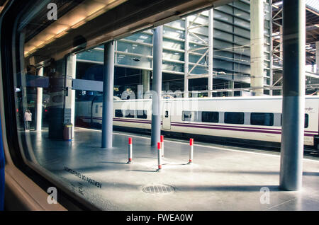 Madrid Atocha is the largest railway station in Madrid. It is the primary station serving commuter trains (Cercanías), - Stock Image