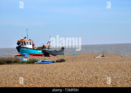 Fishing boats on the Blue Flag shingle beach in the Suffolk Coastal Town of Aldeburgh - Stock Image