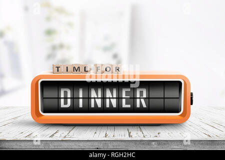 Time for dinner message on a wooden table with a retro alarm clock - Stock Image