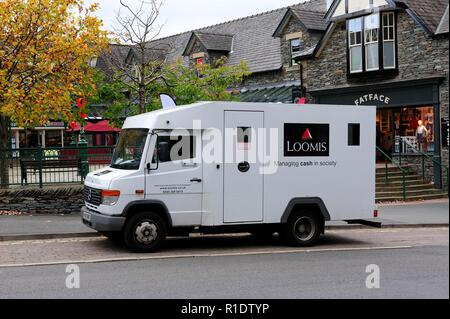 Loomis security cash collection van,Ambleside,Lake District,Cumbria,England,UK - Stock Image