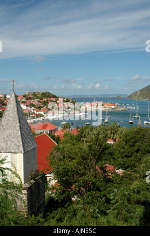 Saint Barth St Barts French West Indies Gustavia Harbor Overview boats buildings orange roofs, trees mountains - Stock Image