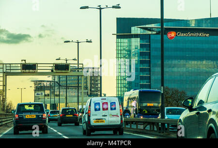 GlaxoSmithKline, global pharmaceuticals company, office block at Brentford, near London. Taken from the busy M4 - Stock Image