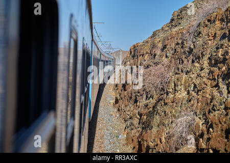 View from train of the land of the Karoo where The Premier Classe train bound for Cape Town makes its way. Karoo, South Africa - January 19, 2019 - Stock Image