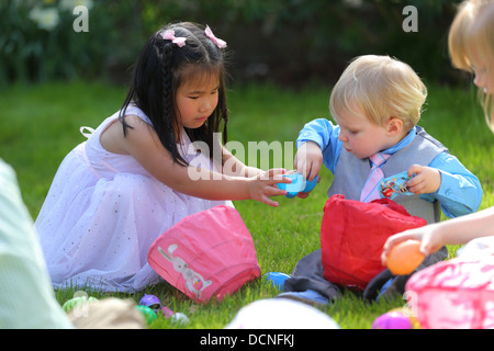 Two children with Easter candy - Stock Image